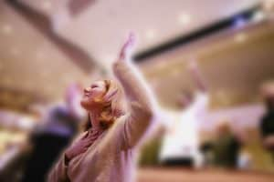 Woman with hands lifted in worship