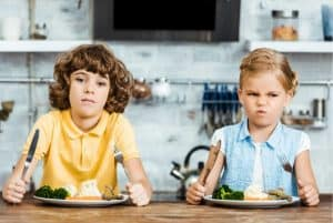 Brother and sister who are complaining about their meal just like God's kids complained about His cooking